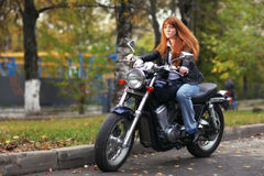 Biker girl on  motorcycle Royalty Free Stock Photo