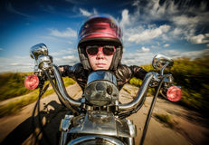 Biker girl and motorcycle (fisheye lens) Royalty Free Stock Photography