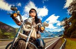 Biker girl on a motorcycle Stock Photo