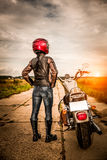 Biker girl on a motorcycle Stock Photos