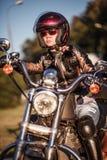 Biker girl on a motorcycle Stock Photos