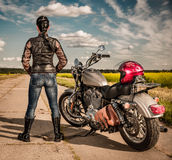 Biker girl on a motorcycle Royalty Free Stock Image