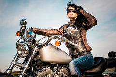 Biker girl on a motorcycle Stock Images