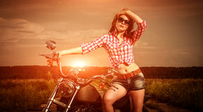 Biker girl and motorcycle Royalty Free Stock Image