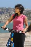 Biker girl near the beach. In summer time Stock Image