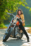 Biker Girl On A Motorcycle Royalty Free Stock Photos