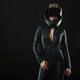 Biker girl posing in studio. In black background royalty free stock images
