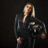 Biker girl posing in studio. In black background stock photos