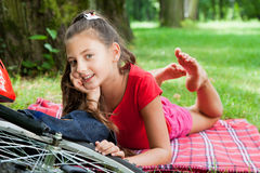 Biker girl relaxing in the park Stock Images