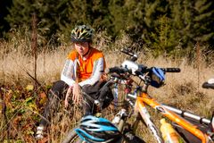 Biker girl rest during the ride royalty free stock photography