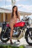 Biker Girl on Retro Motorcycle Stock Photography