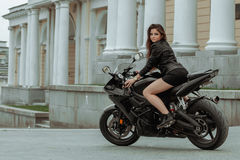 Biker girl rides a motorcycle in the rain. First-person view.  Royalty Free Stock Photos