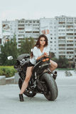 Biker girl rides a motorcycle in the rain. First-person view.  Royalty Free Stock Photo