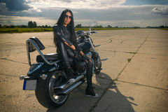 Biker girl sitting on a motorcycle. Royalty Free Stock Photos