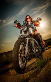 Biker girl sitting on motorcycle Royalty Free Stock Photos
