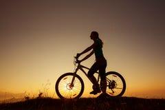 Biker-girl at the sunset stock photos