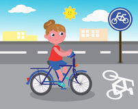 Biker girl vector. Young cartoon riding a bike in town, vector illustration Stock Images