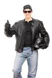 Biker giving thumb up Royalty Free Stock Image
