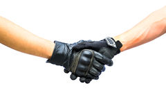 Biker gloves meet in hand shake Stock Photo