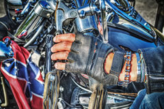 Biker hand with glove on the handlebar Royalty Free Stock Photography