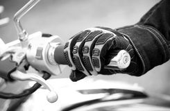 Biker hand rests on the steering wheel motorcycle Royalty Free Stock Photos