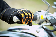 Biker hand rests on the steering wheel motorcycle Royalty Free Stock Images