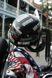 Biker Helmet. Sticker covered biker helmet on handlebar with bandanna Stock Images