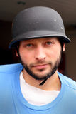 Biker with Helmet. Closeup of an unshaven biker with a German style helmet on. Shallow depth of field Stock Images
