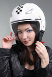 Biker in helmet on head Stock Photo