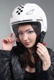 Biker in helmet on head Stock Photo