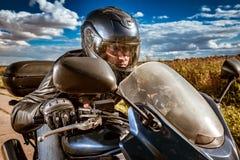 Biker racing on the road stock photos