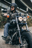 Biker in helmet and leather jacket sitting on a motorcycle Royalty Free Stock Photos