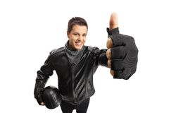 Biker with a helmet making a thumb up sign Stock Image