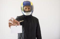 Biker with helmet and offering Stock Image