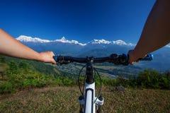 Biker in Himalaya mountains Stock Images
