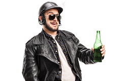Biker holding beer and smoking cigarette Stock Image