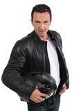 Biker holding helmet Royalty Free Stock Photos