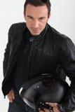 Biker holding helmet Stock Image
