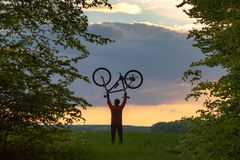 Biker holding his bike upside down Stock Photos