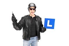 Biker holding an l sign and a key Stock Images
