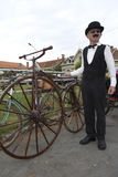 Biker holding an old bicycle. stock photos