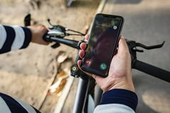 Biker holding smartphone with Incoming call stock photo