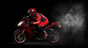 Biker In Red Riding His Bike Stock Images