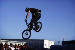 Biker Jumping. People watching a biker do a jump stock photography