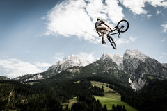 Biker jumps high with his bike Stock Images