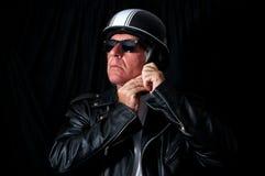 Biker in leather jacket sunglasses helmet Stock Photos