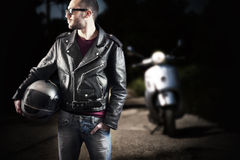 Biker in leather jacket and sunglasses Royalty Free Stock Image