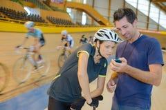 Biker looking at speed. Biker looking at her speed Royalty Free Stock Photos