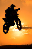 A biker makes a big jump Stock Images
