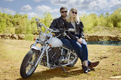 Biker man and blonde girl royalty free stock images